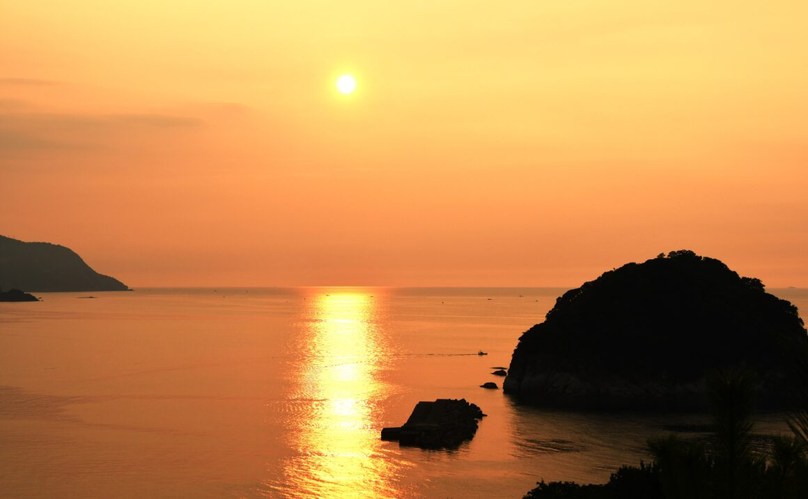 "The Sea of Japan glows red in the sunset,  one of ""Japan's 100 Most Beautiful Sunsets"""